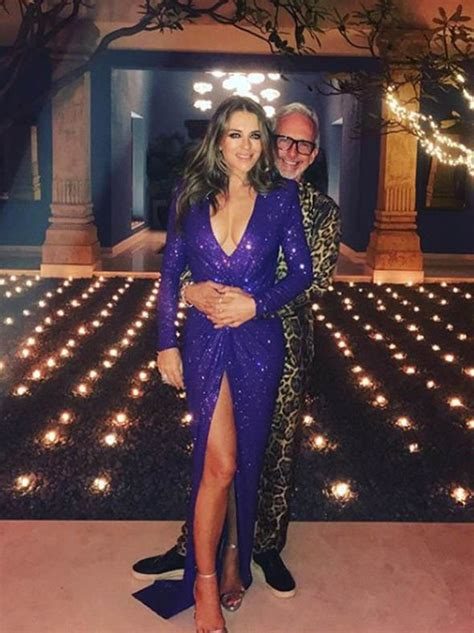 Elizabeth Hurley pictures: Model stuns in plunging purple