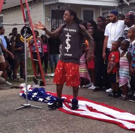 WATCH: Lil Wayne walks all over the American flag while