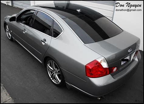 Don Nguyen | Gloss black vinyl'd roof pictures on some